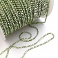 Стразовая цепь 2мм Crystal №111, в зелёной оправе, 1 метр